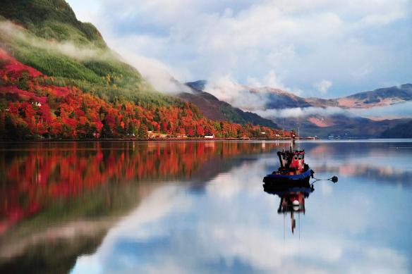 tableau lac et montagne bateau sur eau