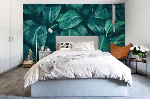 Papier peint tropical Feuilles tropicales vertes
